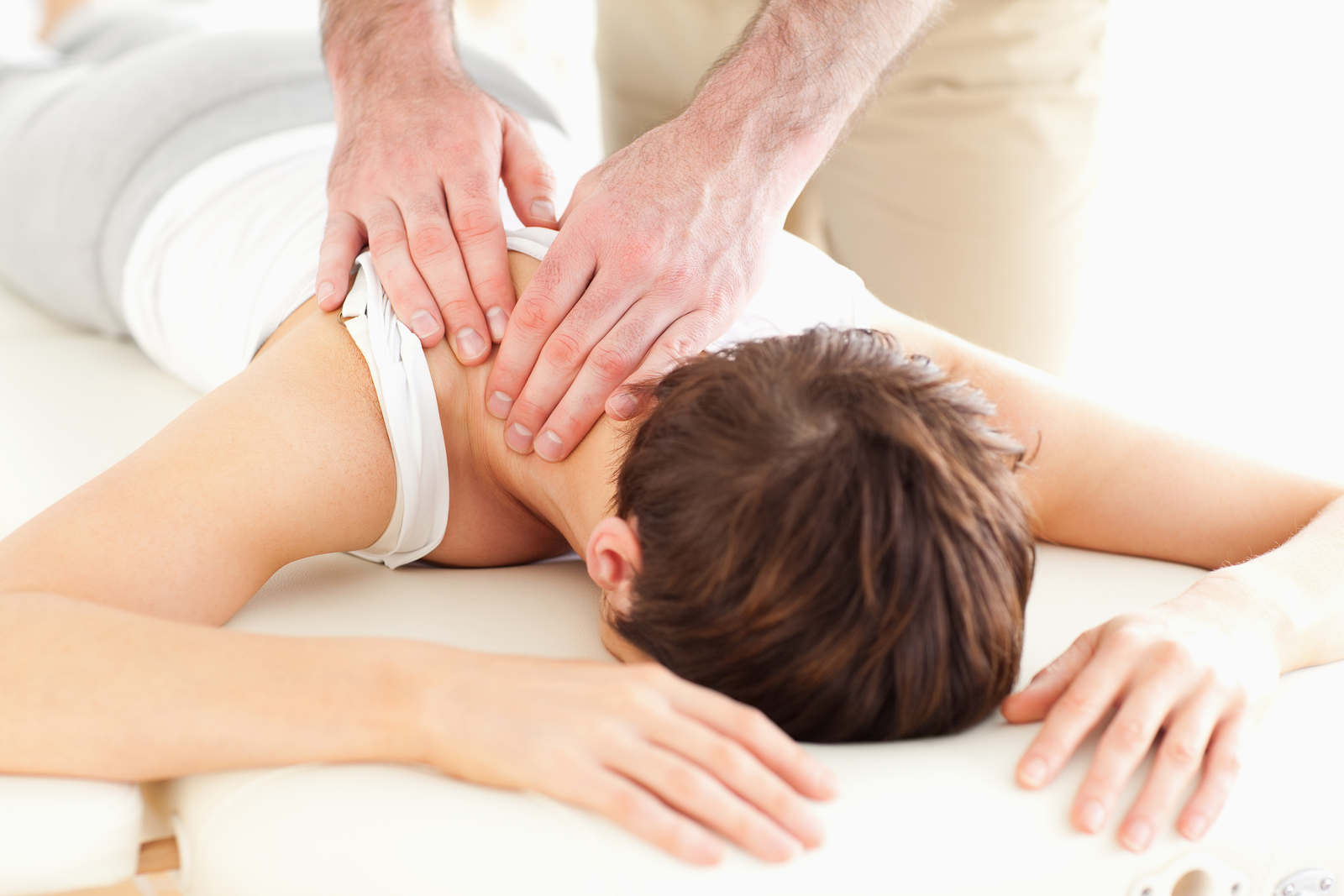 woman receiving massage at corporate massage event with Bangor Chiropractor