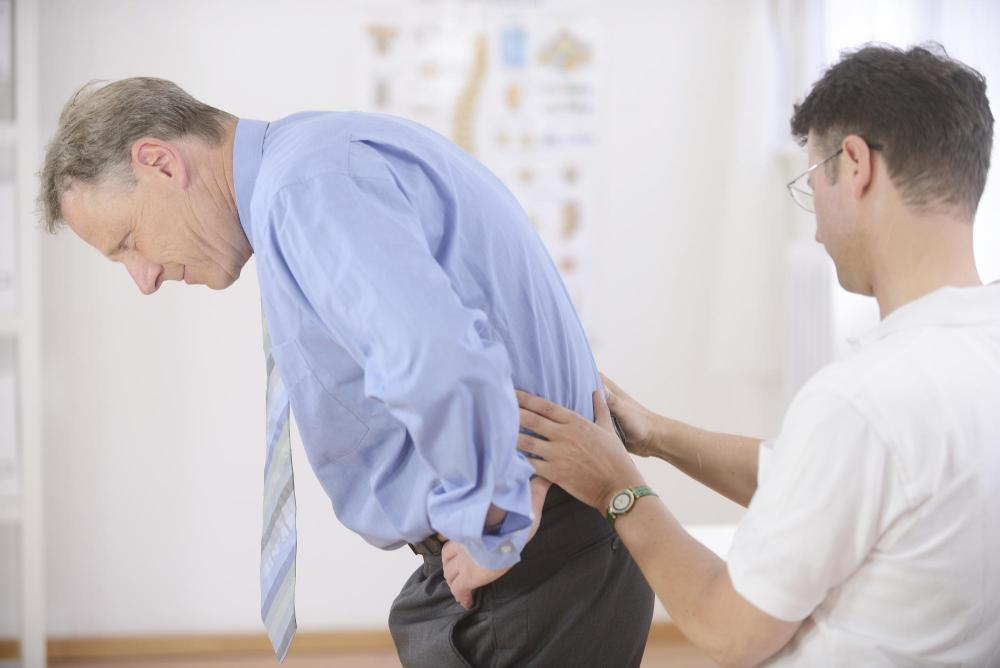 man getting a chiropractic adjustment for his lower back pain